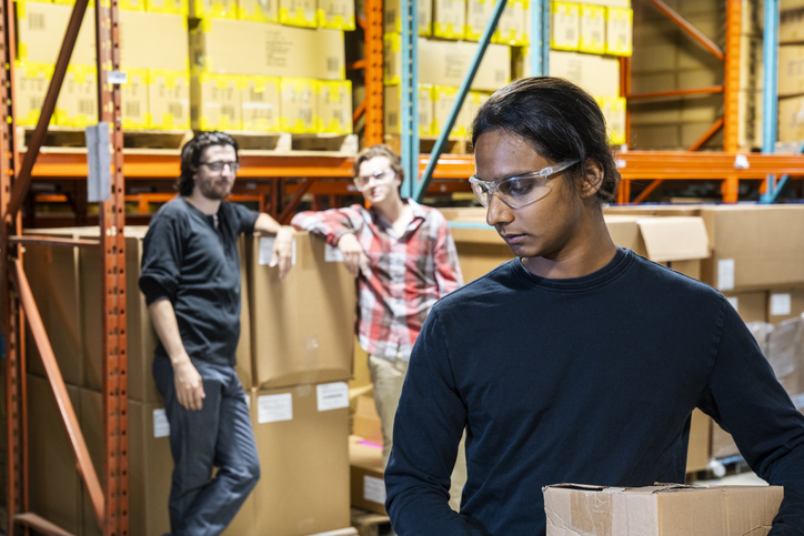 An industrial warehouse worker being the target of bullying